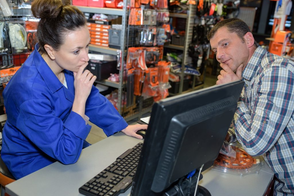 shop assistant looking for spares at the warehouse pc