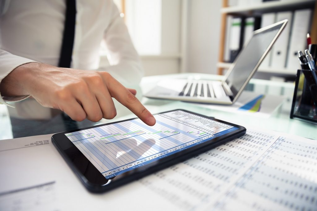 Businessperson Analyzing Gantt Chart On Digital Tablet